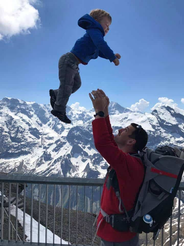 Father throwing son on Switzerland Mountain
