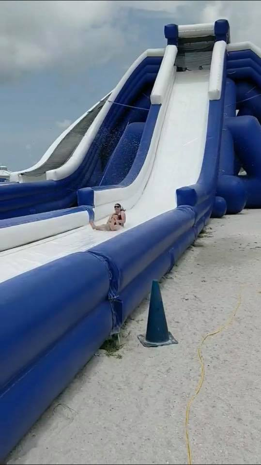 Mom and son riding down huge inflatable slide in St. Pete , Florida