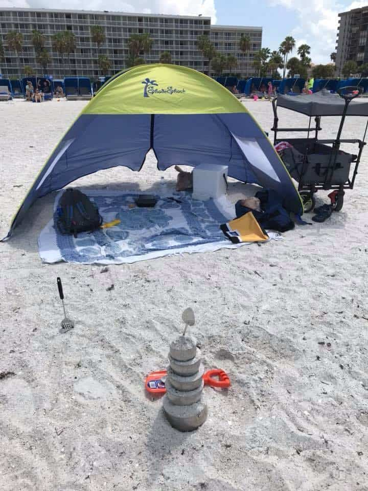 Beach set up complete with pop up tent, blanket, folding wagon