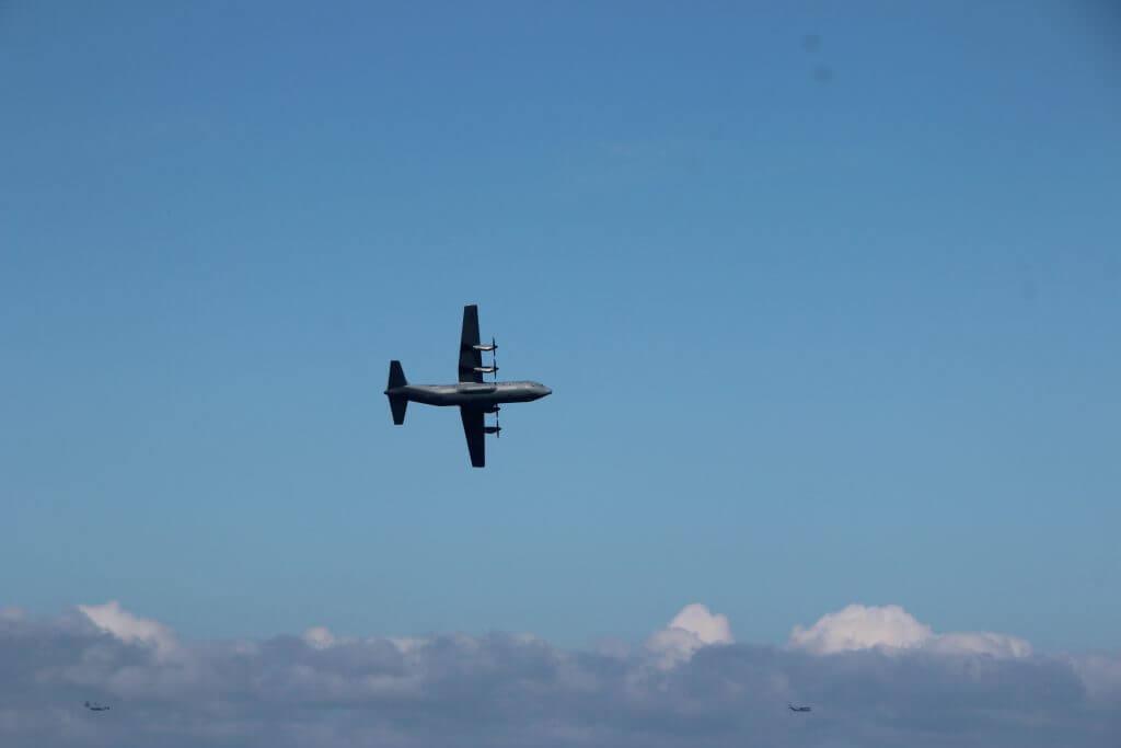 WWII plane flying near Pont du Hoc