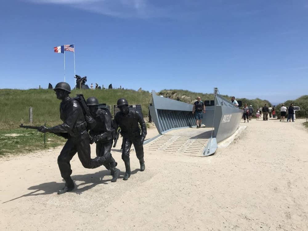 D-day landing boat and soldiers at the entrance to Utah Beach