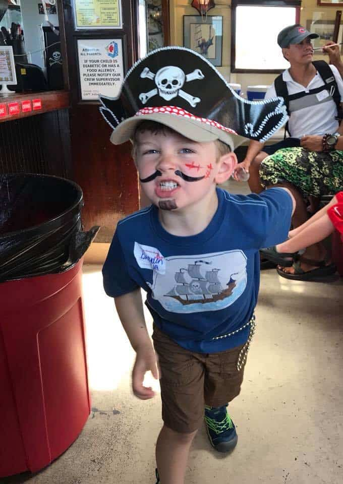 Boy with face painting like a pirate