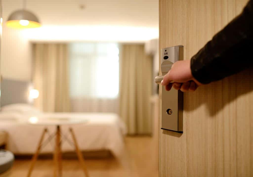 Man holding open hotel room