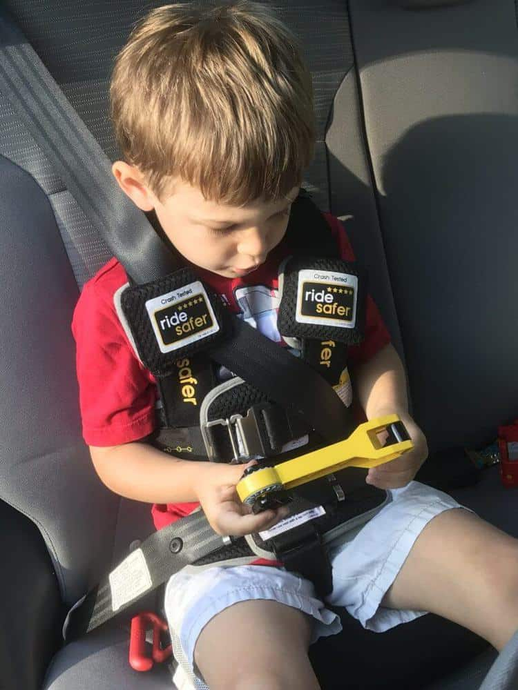 Little boy wearing a ridesafer travel harness